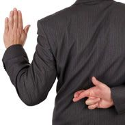 man swearing on oath with fingers crossed behind his back